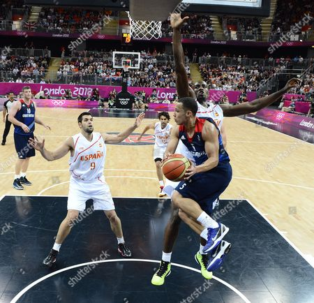 Britain's Andrew Lawrence (r) Drives Past Spain's Serge Ibaka (br) During Their Game in the London 2012 Olympic Games Basketball Competition London Britain 02 August 2012 United Kingdom London