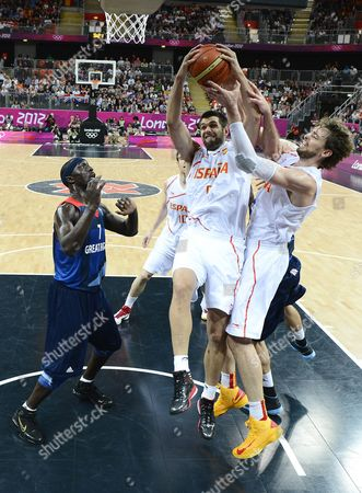Stock Photo of Pau Gasol (r) and Rudy Fernandez of Spain Pull Down a Rebound in Front of Britain's Pops Mensah-bonsuduring the London 2012 Olympic Games Basketball Competition London Britain 02 August 2012 United Kingdom London