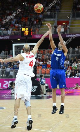 Stock Photo of France's Tony Parker (r) Takes a Shot Against Tunisia's Radhouane Slimane (l) in the Second Half of Their Game at the London 2012 Olympic Games in London Great Britain 04 August 2012 United Kingdom London