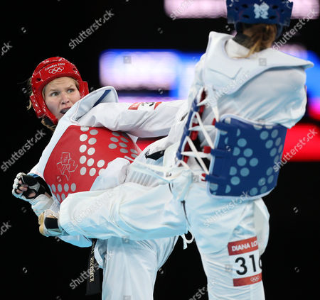 Suvi Mikkonen of Finland (red) Battles Diana Lopez of the Us (blue) in the Women -57kg Repechage at the Excel Centre in the London 2012 Olympic Games Taekwondo Competition 09 August 2012 United Kingdom London