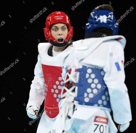 Milica Mandic of Serbia (red) Challenges Opponent Anne-caroline Graffe of France (blue) in the Women's +67kg Gold Medal Final Taekwondo at the Excel Centre in the London 2012 Olympic Games 11 August 2012 United Kingdom London