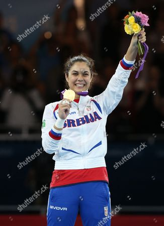 Stock Image of Milica Mandic of Serbia (red) Celebrates Her Win Over Anne-caroline Graffe of France (blue) in the Women's +67kg Gold Medal Final Taekwondo at the Excel Centre in the London 2012 Olympic Games 11 August 2012 United Kingdom London