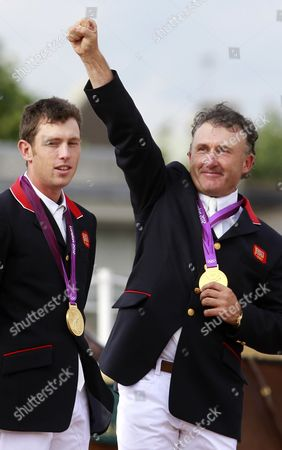 Team Great Britain Members Scott Brash and Peter Charles (r) Pose with Their Gold Medal For the Equestrian Team Jumping Event at the London 2012 Olympic Games Equestrian Jumping Competition in Greenwich Park South East London Britain 06 August 2012 United Kingdom London