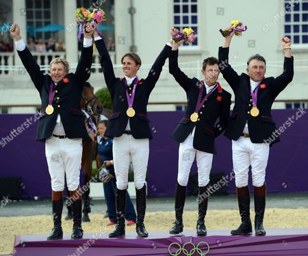 Team Great Britain (l-r) Nick Skelton Ben Maher Scott Brash and Peter Charles Pose with Their Gold Medal For the Equestrian Team Jumping Event at the London 2012 Olympic Games Equestrian Jumping Competition in Greenwich Park South East London Britain 06 August 2012 United Kingdom London