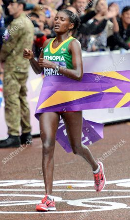 Ethiopia's Tiki Gelana Crosses the Finish Line in the Womens Marathon and Wins the Gold Medal During the London 2012 Olympic Games Athletics Track and Field Events at the Olympic Stadium London Britain 05 August 2012 United Kingdom London