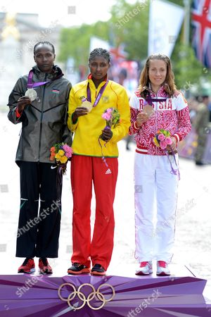 (l to R) Silver Medalist Priscah Jeptoo of Kenya Gold Medalist Tiki Gelana of Ethiopia and Bronze Medalist Tatyana Petrova Arkhipova of Russia on the Podium After the Women's Marathon at the London 2012 Olympic Games Athletics Track and Field Events in London Britain 05 August 2012 United Kingdom London