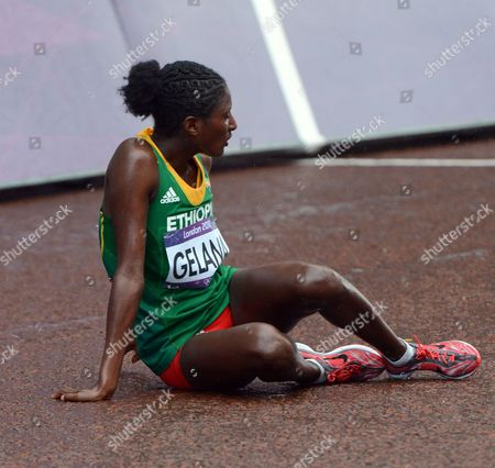 Tiki Gelana of Ethiopia Relaxes After the Women's Marathon For the London 2012 Olympic Games Athletics Marathon Competition London Britain 05 August 2012 United Kingdom London