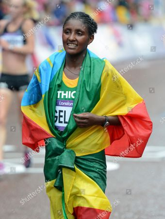 Tiki Gelana of Ethiopia Celebrates Winining Gold in the Women's Marathon at the London 2012 Olympic Games Athletics Track and Field Events in London Britain 05 August 2012 United Kingdom London