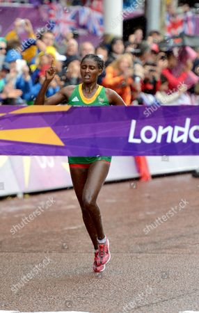 Tiki Gelana of Ethiopia Crosses the Finish Line to Win the Women's Marathon at the London 2012 Olympic Games Athletics Track and Field Events in London Britain 05 August 2012 United Kingdom London