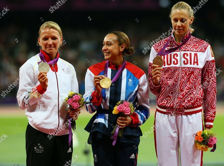 Jennifer Ennis (c) of Britain Celebrates Winning Gold in the Heptathlon with Silver Medalist Lilli Schwarzkopf (l) and Bronze Tatyana Chernova (r) During the London 2012 Olympic Games Athletics Track and Field Events at the Olympic Stadium London Britain 04 August 2012 United Kingdom London