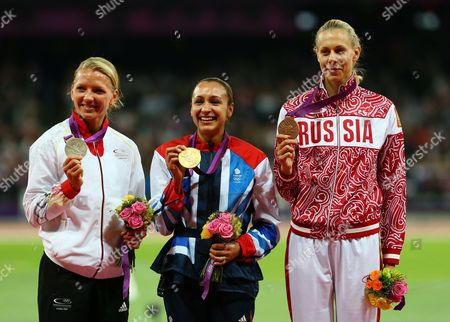 Jessica Ennis (c) of Britain Celebrates Winning Gold in the Heptathlon with Silver Medalist Lilli Schwarzkopf (l) and Bronze Tatyana Chernova (r) During the London 2012 Olympic Games Athletics Track and Field Events at the Olympic Stadium London Britain 04 August 2012 United Kingdom London