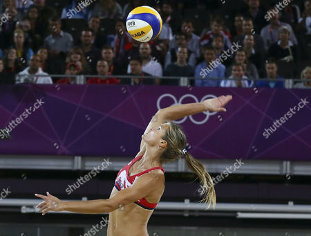 Great Britain's Zara Dampney Spikes the Ball During the Lucky Loser Women's Match Between Austria's Schwaiger /schwaiger and Great Britain's Mullin/dampney For the London 2012 Olympic Games Beach Volleyball Competition at the Horse Guards Parade London Britain 02 August 2012 United Kingdom London