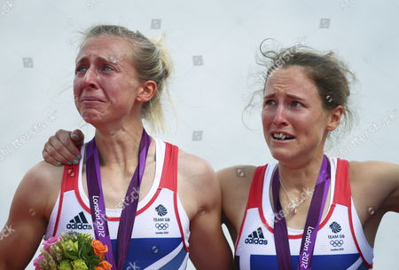 Great Britain's Katherine Copeland (l) and Sophie Hosking Stand Crying on the Podium and Show Their Gold Medals Winning in the Lightweight Women's Double Sculls During the London 2012 Olympic Games Rowing Competition at the Eton Dorney Rowing Centre Near the Village of Dorney West of London Britain 04 August 2012 United Kingdom Dorney