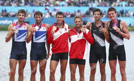 New Zealand Bronze Medalists in the Lightweight Men's Double Sculls Storm Uru (2-r) and Peter Taylor (r) Great Britain Silver Medalists Zac Purchase (l) and Mark Hunter (2-l) Denmark Gold Medalists Mads Rasmussen (c-l) and Rasmus Quist (c-r) During the London 2012 Olympic Games Rowing Competition at the Eton Dorney Rowing Centre Near the Village of Dorney West of London Britain 04 August 2012 United Kingdom Dorney