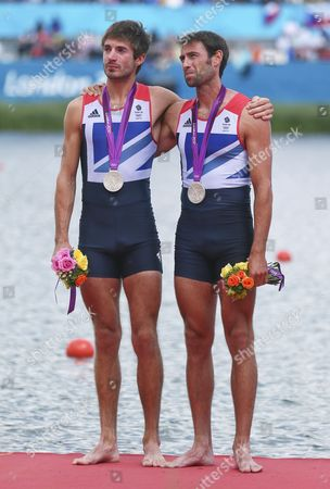 Great Britain's Silver Medalists in the Lightweight Men's Double Sculls Zac Purchase (l) and Mark Hunter (r) Stand on the Podium During the London 2012 Olympic Games Rowing Competition at the Eton Dorney Rowing Centre Near the Village of Dorney West of London Britain 04 August 2012 United Kingdom Dorney