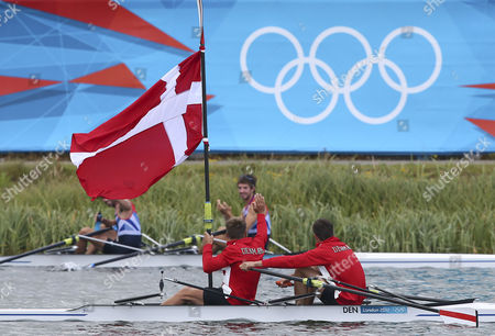 Lightweight Men's Double Sculls Gold Medalists Mads Rasmussen (r) and Rasmus Quist (l) of Denmark Wave to the Crowd As Great Britain Silver Medalists Zac Purchase and Mark Hunter Applaud During the London 2012 Olympic Games Rowing Competition at the Eton Dorney Rowing Centre Near the Village of Dorney West of London Britain 04 August 2012 United Kingdom Dorney