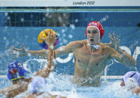 Great Britain's Ed Scott Goes Up to Make a Save During the Water Polo Men's Preliminary Round Group B Match Between Great Britain and Montenegro the London 2012 Olympic Games Water Polo Competition London Britain 06 August 2012 United Kingdom London