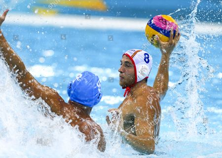 Spain's Albert Espanol Lifante (r) Fires a Shot Past Italy's Valentino Gallo (l) During the Water Polo Mens Preliminary Round Group a Match Between Italy and Spain at the London 2012 Olympic Games Water Polo Competition London Britain 06 August 2012 United Kingdom London