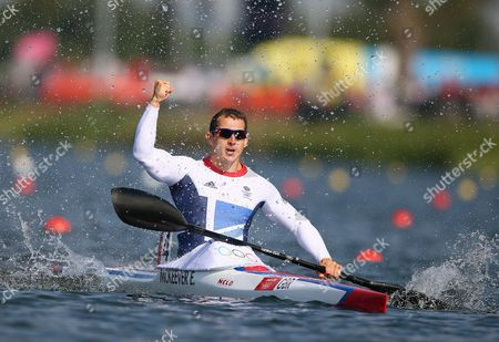 Great Britain's Ed Mckeever Celebrates Gold in the Kayak Single (k1) 200m Men's Canoe Sprint Final During the London 2012 Olympic Games Canoe Sprint Competition at the Eton Dorney Rowing Centre Near the Village of Dorney West of London Britain 11 August 2012 United Kingdom Dorney