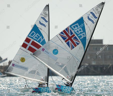 Stock Photo of Ben Ainslie of Great Britain (r) Competes Against Jonas Hogh-christensen of Denmark (l) in the Men's Finn Class Medal Race During the London 2012 Olympic Games Sailing Competition in Weymouth Britain 05 August 2012 Weymouth is Hosting the Sailing Competition For the London 2012 Olympic Games From 27 July to 12 August 2012 Ainslie Won the Gold Medal and Jonas Hogh-christensen the Silver United Kingdom Weymouth