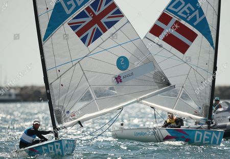 Ben Ainslie of Great Britain (l) Competes Against Jonas Hogh-christensen of Denmark (r) in the Men's Finn Class Medal Race During the London 2012 Olympic Games Sailing Competition in Weymouth Britain 05 August 2012 Weymouth is Hosting the Sailing Competition For the London 2012 Olympic Games From 27 July to 12 August 2012 Ainslie Won the Gold Medal and Jonas Hogh-christensen the Silver United Kingdom Weymouth
