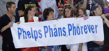 Debbie Phelps (c) the Mother of Michael Phelps of the United States and His Sisters Hilary Phelps (l of Centre) and Whitney Phelps (r of Centre) Hold a Poster During the Award Ceremony For the Men's 4x100m Medley Relay Final During the Swimming Competition Held at the Aquatics Center During the London 2012 Olympic Games in London England 04 August 2012 United Kingdom London