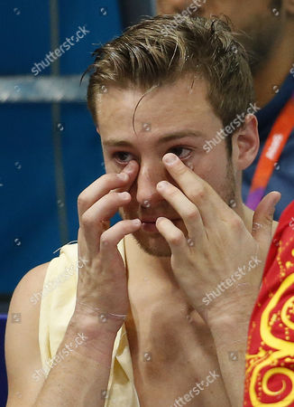 Stock Image of Matthew Mitcham of Australia Cries After Failing to Qualify For the Final in the Men's 10m Platform Semifinal During the Diving Competition Held at the Aquatics Center During the London 2012 Olympic Games in London Great Britain 11 August 2012 United Kingdom London