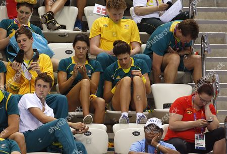 Australia's Blair Evans (center Row L) and Teammate Stephanie Rice (center Row R) Polish Their Fingernails at the Swimming Competitions Held at the Aquatics Center During the London 2012 Olympic Games in London England 3 August 2012 United Kingdom London