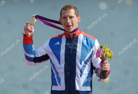 Great Britain's Ed Mckeever Shows His Gold Medal on the Podium After Winning the Men's Kayak Single (k1) 200m Final During the London 2012 Olympic Games Canoe Sprint Competition at the Eton Dorney Rowing Centre Near the Village of Dorney West of London Britain 11 August 2012 United Kingdom Dorney