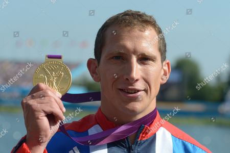 Stock Photo of Great Britain's Ed Mckeever Shows His Gold Medal After Winning the Men's Kayak Single (k1) 200m Final During the London 2012 Olympic Games Canoe Sprint Competition at the Eton Dorney Rowing Centre Near the Village of Dorney West of London Britain 11 August 2012 United Kingdom Dorney