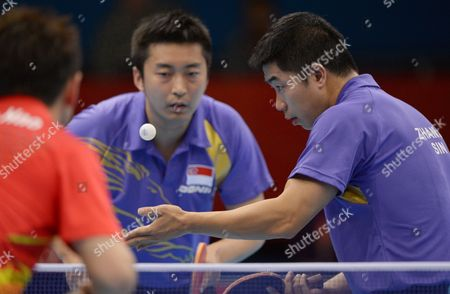 Zi Yang and Jian Zhan (r) of Singapore Compete Against Zhang/wang of China in the Men's Table Tennis Team Quarterfinals During the London 2012 Olympic Games London Britain 05 August 2012 United Kingdom London