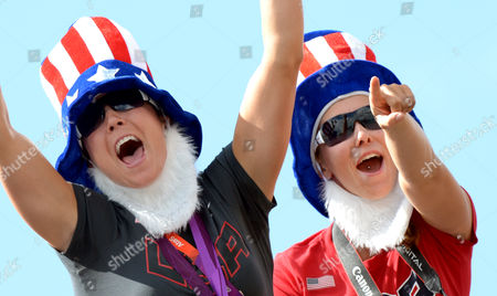 Team Usa Women's Quadruple Sculls' Bronze Medalists Natalie Dell (l) and Megan Kalmoe (r) Celebrate Usa Women's Eight Gold During the London 2012 Olympic Games Rowing Competition at the Eton Dorney Rowing Centre Near the Village of Dorney West of London Britain 02 August 2012 United Kingdom Dorney