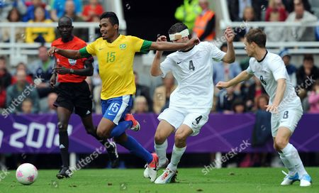 Brazil's Alex Sandro Resulted in a Red Card by Referee Bakary Gassama and His 2nd Yellow Card After Diving After the Challenge From New Zealand's Tim Myers (c) During the London 2012 Olympic Games Soccer Match Between Brazil and New Zealand at the St James' Park Stadium London Britain 01 August 2012 United Kingdom Newcastle Upon Tyne
