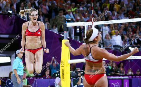 Usa's Kerri Walsh Jennings (l) and Misty May-treanor Celebrate Their Win Over Compatriots Kessy/ross in the Women's Gold Medal Match at the London 2012 Olympic Games Beach Volleyball Competition at the Horse Guards Parade London Britain 08 August 2012 United Kingdom London