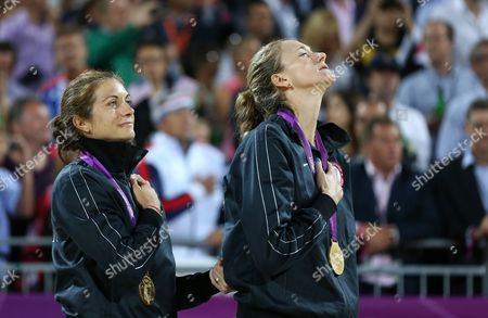 Usa's Kerri Walsh Jennings (r) and Misty May-treanor Celebrate Their Victory in the Women's Gold Medal Match at the London 2012 Olympic Games Beach Volleyball Competition at the Horse Guards Parade London Britain 08 August 2012 United Kingdom London