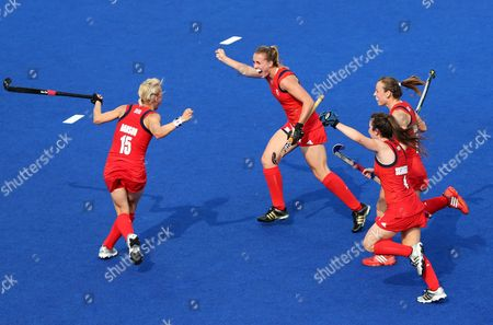 Stock Image of Britain's Alex Danson (l) Celebrates a Goal with (l-r) Laura Bartlett Laura Unsworth and Chloe Rogers During the Field Hockey Bronze Medal Match at the London 2012 Olympic Games Field Hockey Competition London Britain 10 August 2012 United Kingdom London