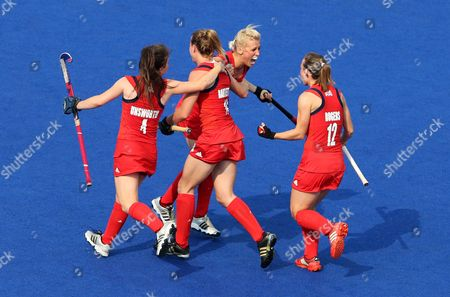 Stock Photo of Brtiain's Alex Danson (2nd R) Celebrates with Laura Bartlett (c) Laura Unsworth (l) and Chloe Rogers During the Field Hockey Bronze Medal Match at the London 2012 Olympic Games Field Hockey Competition London Britain 10 August 2012 United Kingdom London