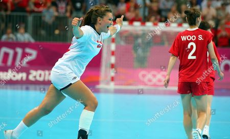 Norway's Amanda Kurtovic (l) Celebrates While South Korea's Woo Sun Hee (r) Dejects After the Semifinal Handball Match Between Norway and South Korea at the London 2012 Olympics Games in London Britain 09 August 2012 United Kingdom London