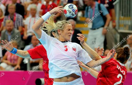 Norway's Ida Alstad (l) in Action Against South Korea's Woo Sun Hee (r) During the Semifinal Handball Match Between Norway and South Korea at the London 2012 Olympics Games in London Britain 09 August 2012 United Kingdom London