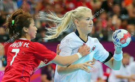 Norway's Linn Jorum Sulland (r) in Action Against South Korea's Woo Sun Hee (l) During the Semifinal Handball Match Between Norway and South Korea at the London 2012 Olympics Games in London Britain 09 August 2012 United Kingdom London