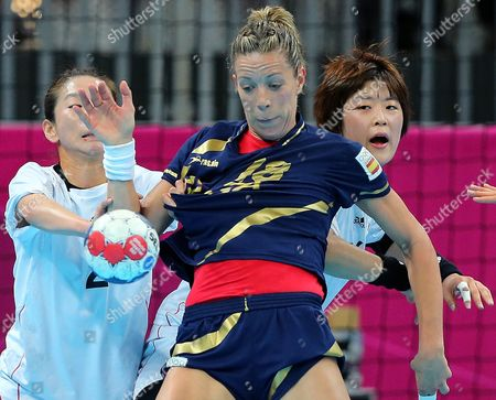 Spain's Begona Fernandez Molinos (c) in Action Against South Korea's Woo Sun Hee (l) During the Bronze Medal Handball Match Between South Korea and Spain at the London 2012 Olympics Games in London Britain 11 August 2012 United Kingdom London