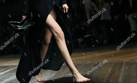 A Model Carries Her Shoes After One of Them Fell Off During the Show of German Designers and Twin Sisters Annette Und Daniela Felder For Their Label Felder Felder During the London Fashion Week Fall/winter 2013 at Somerset House in London Britain 15 February 2013 the Fashion Week Runs From 15 to 19 February United Kingdom London