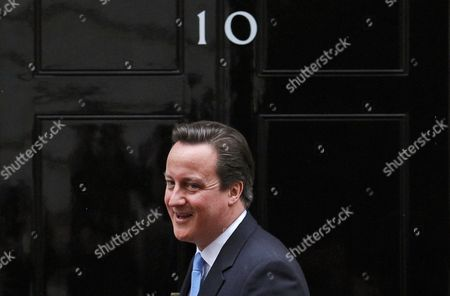British Prime Minister David Cameron Smiles Prior His Meeting with Nigerian President Goodluck Ebele Azikiwe Jonathan (out of the Frame) Outside of No 10 Downing Street Prior to Their Meeting in London Britain 11 February 2013 United Kingdom London