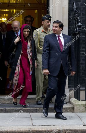Pakistani Foreign Minister Hina Rabbani Khar (l) and Prime Minister Raja Pervez Ashraf of Pakistan (r) on the Steps of N10 After Meeting British Prime Minister David Cameron (not Seen) in Downing Street in London Britain 12 February 2013 Mr Ashraf is in the United Kingdom on a Four Day Visit United Kingdom London