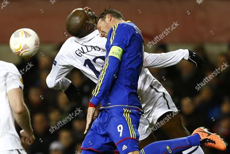 William Gallas (l) of Tottenham Hotspur Vies For Ball with Marco Streller (r) of Fc Basel During Their Uefa Europa League Quarter Final First Leg Match Between Tottenham Hotspur and Fc Basel at the White Hart Lane Stadium in London Britain 04 April 2013 United Kingdom London