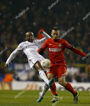 William Gallas of Tottenham Hotspur (l) in Action Against Antonio Cassano of Fc Internazionale Milano (r) During the Uefa Europa League Round of 16 First Leg Match Between Tottenham Hotspur and Inter Milan at White Hart Lane in London Britain 07 March 2013 United Kingdom London