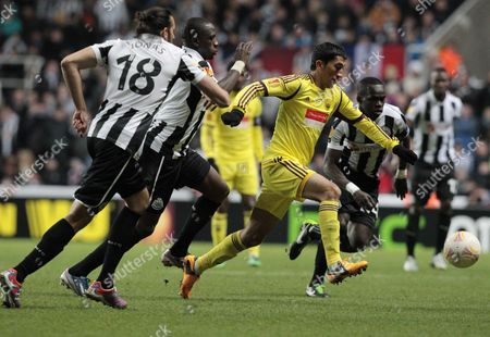 Anzhi Makhachkala's Odil Ahmedov (r) Fails to Beat Newcastle Defence During Their Europa League Round of 16 Second Leg Soccer Match at the Saint James' Park Stadium in Newcastle Britain 14 March 2013 United Kingdom Newcastle