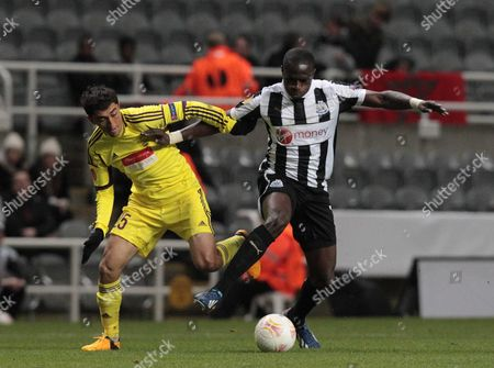 Newcastle's Moussa Sissoko (r) Vies For the Ball with Anzhi Makhachkala's Odil Ahmedov During Their Europa League Round of 16 Second Leg Soccer Match at the Saint James' Park Stadium in Newcastle Britain 14 March 2013 United Kingdom Newcastle
