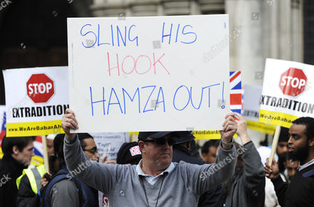 A Man Holds a Placard Calling For the Extradition of Abu Hamza (c) Outside the Royal Courts of Justice in London Britain 05 October 2012 Babar Ahmad and Syed Talha Ahsan Along with Radical Islamic Cleric Abu Hamza Al-masri and Two Other Terror Suspects Are Expected to Find out if They Have Succeeded in Their Latest Legal Move to Avoid Extradition From Britain to the Usa to Stand Trial on Terrorism Charges United Kingdom London