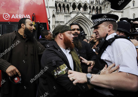 Demonstrators Scuffle with Police Outside the Royal Courts of Justice in London Britain 05 October 2012 Babar Ahmad and Syed Talha Ahsan Along with Radical Islamic Cleric Abu Hamza Al-masri and Two Other Terror Suspects Are Expected to Find out if They Have Succeeded in Their Latest Legal Move to Avoid Extradition From Britain to the Usa to Stand Trial on Terrorism Charges United Kingdom London
